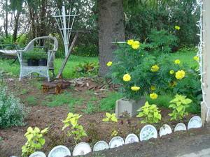 Bordure fai da te o da riciclo un quadrato di giardino - Recinti per giardini ...